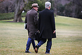 Acting White House Chief of Staff Mick Mulvaney left, and United States National Security Advisor Robert C. O'Brien walk on the South Lawn of the White House before boarding Marine One with US President Donald J. Trump on January 13, 2020 in Washington, DC. President Trump and first lady Melania Trump will attend the College Football Playoff National Championship in New Orleans, Louisiana.<br /> Credit: Oliver Contreras / Pool via CNP