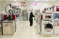 June 19, 2014 - Isfahan, Iran. A woman shops in an appliance center inside the Isfahan City Center Mall, one of the biggest in the country. © Thomas Cristofoletti / Ruom