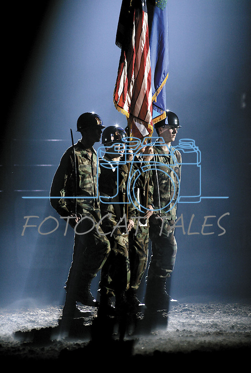Members of the University of Nevada, Reno Army ROTC Sierra Color Guard march into the Reno Events Center, in Reno, Nev., on March 5, 2006, at the beginning of the Professional Bull Riders competition. Copyright Cathleen Allison