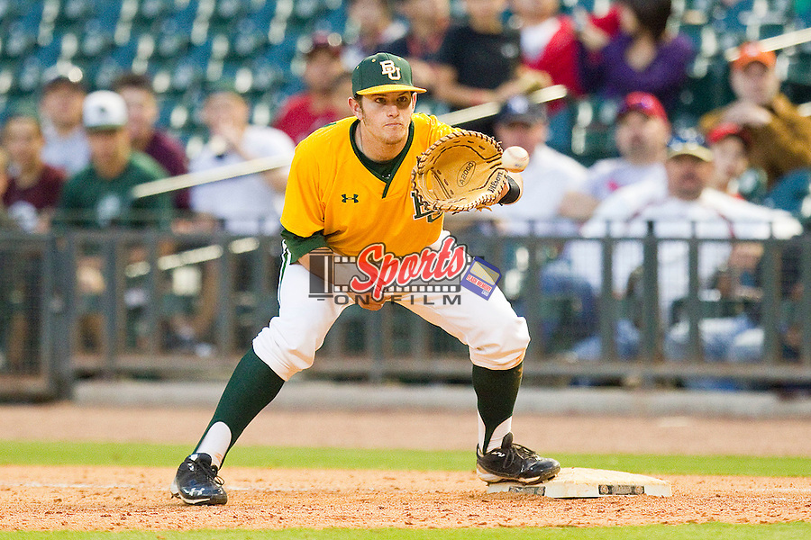 First baseman Max Muncy #9 of the Baylor Bears waits for a throw against the Rice Owls at Minute Maid Park on March 6, 2011 in Houston, Texas.  Photo by Brian Westerholt / Four Seam Images