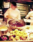 USA, California, Berkeley, chef preparing food in kitchen, Chez Panisse