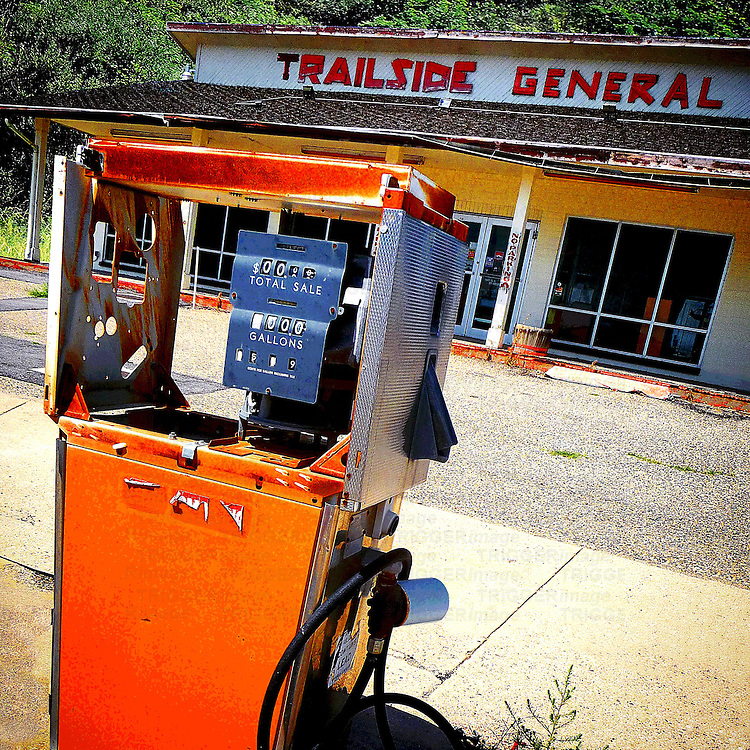Old retro petrol pump in USA at garage