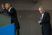 United States President Barack Obama delivers remarks at a campaign event for Terry McAuliffe, right, at Washington-Lee High School, Arlington, Virginia, U.S., on Sunday, November 3, 2013. McAuliffe is the Democratic nominee in the 2013 Virginia gubernatorial election. <br /> Credit: Pete Marovich / Pool via CNP