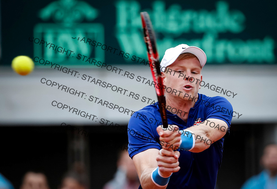 BELGRADE, SERBIA - JULY 17: Kyle Edmund of Great Britain returns the ball to Dusan Lajovic of Serbia during day three of the Davis Cup Quarter Final match between Serbia and Great Britain on Stadium Tasmajdan on July 17, 2016 in Belgrade, Serbia. (Photo by Srdjan Stevanovic/Getty Images)