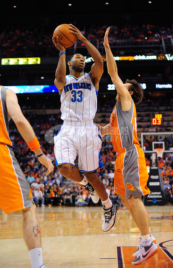 Mar. 25, 2011; Phoenix, AZ, USA; New Orleans Hornets guard (33) Willie Green takes a shot in the first half against the Phoenix Suns at the US Airways Center. Mandatory Credit: Mark J. Rebilas-