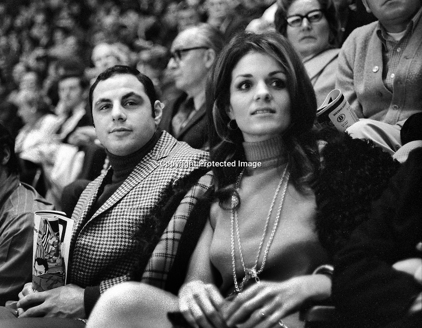Oakland A's 3rd baseman Sal Bando and his wife Sandy in the crowd watching the California Golden Seals hockey game at the Oakland Alameda County Coliseum Arena.  (1976) photo/Ron Riesterer)