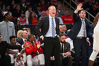 NEW YORK, NY - Sunday December 13, 2015: The St. John's University Head Coach Chris Mullen gives direction to his team.  St. John's defeats Syracuse 84-72 during the NCAA men's basketball regular season at Madison Square Garden in New York City.