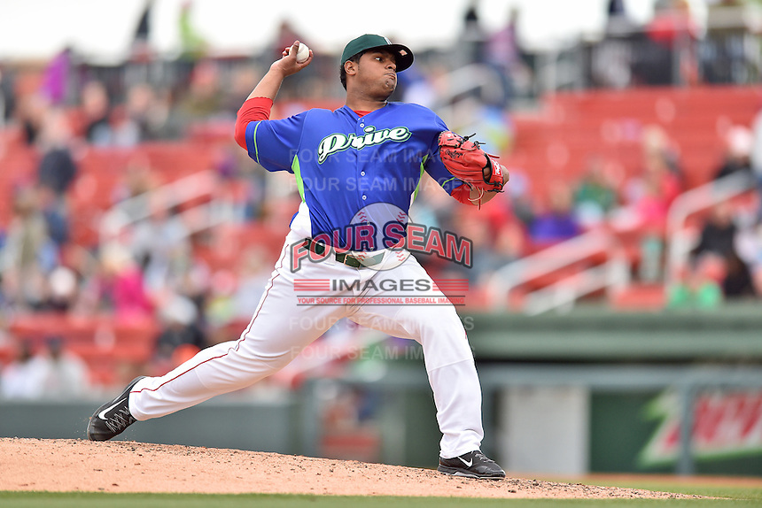 Greenville Drive pitcher Dioscar Romero (28) delivers a pitch during a game against the Asheville Tourists at Fluor Field on April 10, 2016 in Greenville South Carolina. The Drive defeated the Tourists 7-4. (Tony Farlow/Four Seam Images)