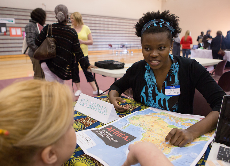 Ohio University student Kombe Kapatamoyo speaks with a participant in the Vinton County High School Diversity Fair, held in the school gym on March 21, 2014. Photo by Lauren Pond