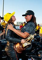 Nov 17, 2019; Pomona, CA, USA; NHRA pro stock motorcycle rider Jianna Salinas celebrates with mother Monica Salinas after winning the Auto Club Finals at Auto Club Raceway at Pomona. Mandatory Credit: Mark J. Rebilas-USA TODAY Sports
