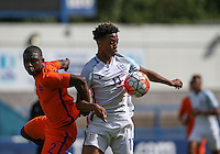 Chris Willock (Arsenal) of England U19 holds off Sherel Floranus (Sparta Rotterdam) of Holland during the International match between England U19 and Netherlands U19 at New Bucks Head, Telford, England on 1 September 2016. Photo by Andy Rowland.