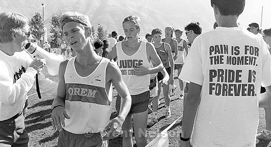 Pained runners and &quot;pain is for the moment. pride is forever&quot; t-shirt at cross country meet.<br />