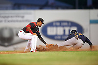 Batavia Muckdogs second baseman Rony Cabrera (26) tags Vincent Jackson (40) sliding into second during a game against the State College Spikes on June 23, 2016 at Dwyer Stadium in Batavia, New York.  State College defeated Batavia 8-4.  (Mike Janes/Four Seam Images)
