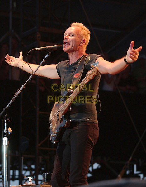 "STING of ""The Police"".2nd Annual Virgin Festival By Virgin Mobile - Day One held at Pimilco Race Course, Baltimore, Maryland, USA,.04 August 2007..live in concert on stage gig guitar arms hands out.CAP/ADM/DS.©Devin Simmons/AdMedia/Capital Pictures."