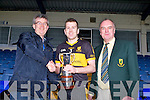 Patrick O'Donoghue and Eats Kerry Chairman Diarmaid Griffin presents the O'Donoghue Cup to Dr Crokes captain Luke Quinn after they defeated Rathmore in the Fitzgerald Stadium on Sunday