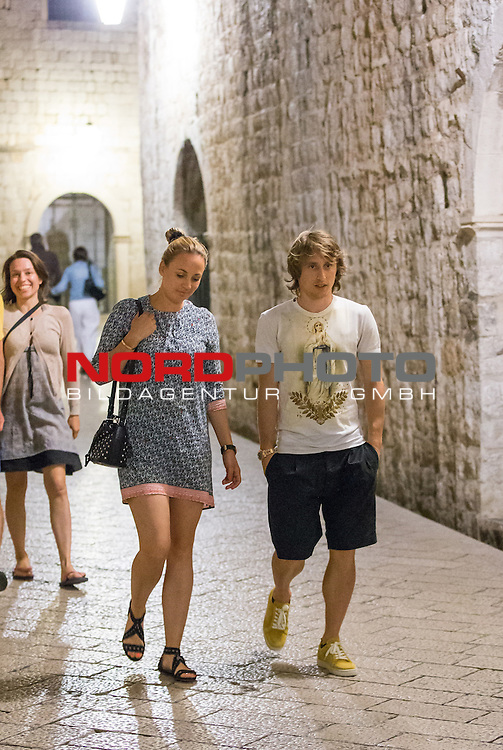 18.06.2015., Dubrovnik, Croatia - Luka Modric arrived in Dubrovnik with his wife Vanja and friends to have a relaxing break at the Adriatic Coast. After dinner at the restaurant 360, whose terrace is located on top of the walls of Dubrovnik, he did not miss an evening walk through Stradun with his wife Vanja. Photo: Grgo Jelavic/PIXSELL