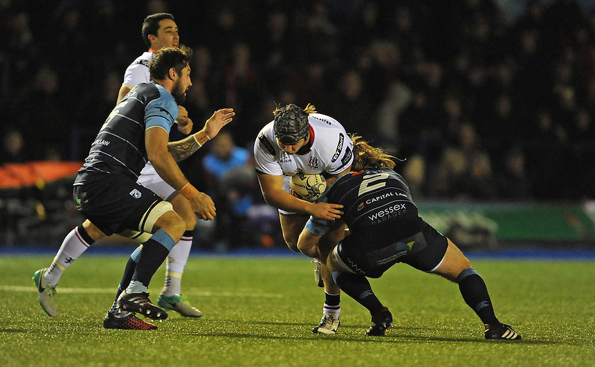 Ulster's Kyle McCall is tackled by Cardiff Blues' Kristian Dacey<br /> <br /> Photographer Ian Cook/CameraSport<br /> <br /> Guinness PRO12 Round 10 - Cardiff Blues v Ulster Rugby - Saturday 3rd December 2016 - Cardiff Arms Park - Cardiff<br /> <br /> World Copyright &copy; 2016 CameraSport. All rights reserved. 43 Linden Ave. Countesthorpe. Leicester. England. LE8 5PG - Tel: +44 (0) 116 277 4147 - admin@camerasport.com - www.camerasport.com