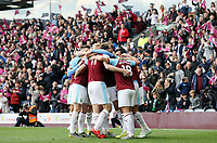 Chris Wood is mobbed by team-mates as he and Dwight McNeil celebrate scoring their sides second goal <br /> <br /> Photographer Rich Linley/CameraSport<br /> <br /> The Premier League - Saturday 13th April 2019 - Burnley v Cardiff City - Turf Moor - Burnley<br /> <br /> World Copyright © 2019 CameraSport. All rights reserved. 43 Linden Ave. Countesthorpe. Leicester. England. LE8 5PG - Tel: +44 (0) 116 277 4147 - admin@camerasport.com - www.camerasport.com