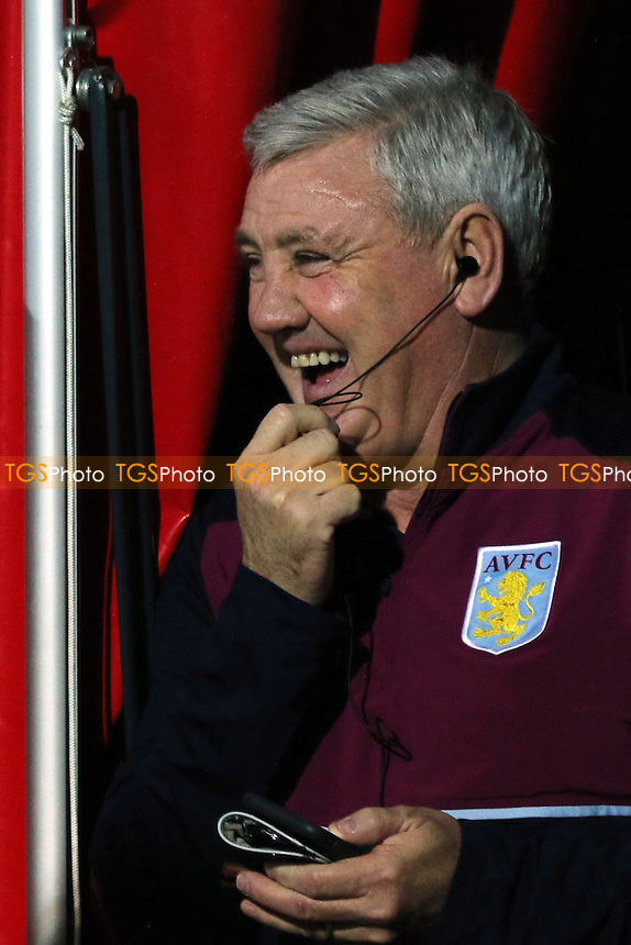 Aston Villa Manager, Steve Bruce, receives an amusing telephone call pre-match during Brentford vs Aston Villa, Sky Bet EFL Championship Football at Griffin Park on 31st January 2017