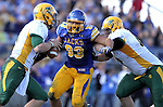BROOKINGS, SD - SEPTEMBER 28:   Chase Douglas #93 from South Dakota State University eyes quarterback Brock Jensen #16 from North Dakota State University in the third quarter of their game Saturday afternoon at Coughlin Alumni Stadium in Brookings. (Photo by Dave Eggen/Inertia)