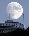 The moon rises over the Summit House atop Mount Holyoke in Hadley Monday night.