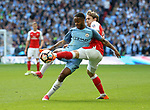 Arsenal's Nacho Monreal tussles with Manchester City's Raheem Sterling during the FA Cup Semi Final match at Wembley Stadium, London. Picture date: April 23rd, 2017. Pic credit should read: David Klein/Sportimage