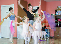 "NWA Democrat-Gazette/CHARLIE KAIJO Cailey Funkhouser (center) leads a dance during a ballet summer mini-camp, Monday, July 8, 2019 at Radiance Ballet studio in Centerton. <br /> <br /> The studio is holding a three day summer mini-camp this week for three and four year olds. The class introduces youth to the foundations of ballet, and for many students, it's their first time. The class teaches them how their body's move and ways to use their imagination.<br /> <br /> ""[Ballet is] great for sensory input, coordination, balance and focus,"" said Tara Klamm, the studio's director. ""A lot of them it's the first time they've been in a structured class environment."""