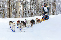 Chandler Wappett on the trail passes Knik Hall after leaving the start at Knik Lake during the start of the Junior Iditarod on Saturday February 25, 2017. <br /> <br /> <br /> Photo by Jeff Schultz/SchultzPhoto.com  (C) 2017  ALL RIGHTS RESVERVED