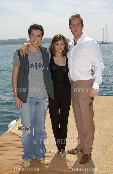 Actress RACHAEL LEIGH COOK with actors MARCUS THOMAS (in white) & PAULO CONSTANZO at the Cannes Film Festival to promote their movie Scorched..16MAY2002. © Paul Smith / Featureflash