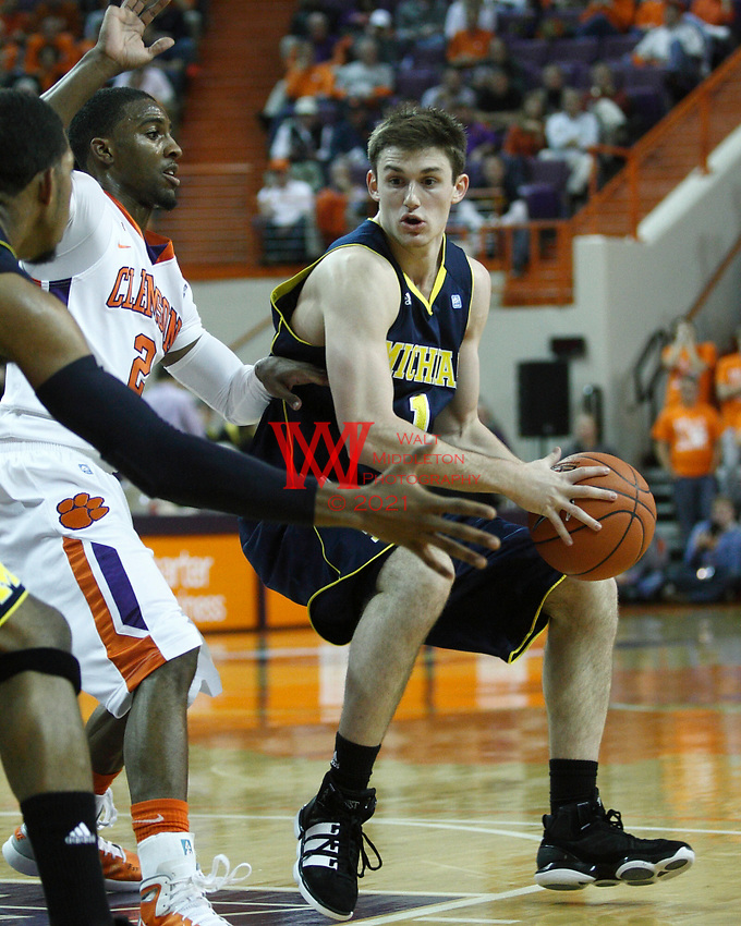 Nov 30, 2010; Clemson, SC, USA; Michigan Wolverines guard Stu Douglass (1) passes the ball to Michigan guard Darius Morris (4) in the game against the Clemson Tigers at Littlejohn Coliseum. Mandatory Credit: Daniel Shirey/WM Photo -US PRESSWIRE