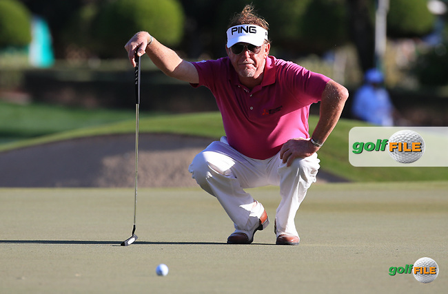 Miguel Angel Jimenez (ESP) in action during Round Two (Pink Friday) of the 2016 Omega Dubai Desert Classic, played on the Emirates Golf Club, Dubai, United Arab Emirates.  05/02/2016. Picture: Golffile | David Lloyd<br /> <br /> All photos usage must carry mandatory copyright credit (&copy; Golffile | David Lloyd)