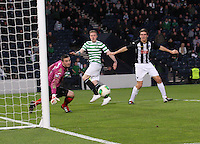 Denny Johnstone watches his winning header heading for goal as Ryan Goodfellow is beaten in the Dunfermline Athletic v Celtic Scottish Football Association Youth Cup Final match played at Hampden Park, Glasgow on 1.5.13.