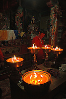 Yak butter candles light the small chapel in the Yumbulagang fortress in the Yarlung Valley of Tibet.