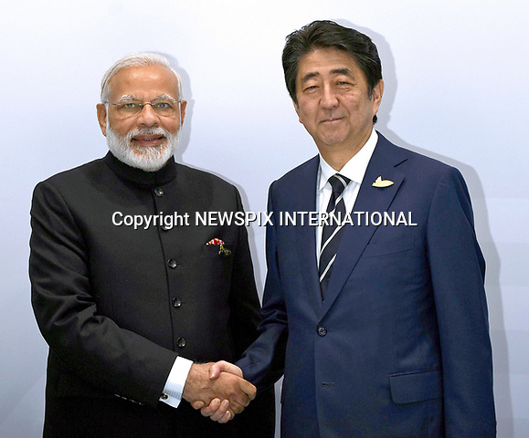 07.07.2017; Hamburg, Germany:  SHINZO ABE AND NARENDRA MODI <br /> meet at the G20 Summit in Hamburg Germany.<br /> Mandatory Credit Photo: &copy;NEWSPIX INTERNATIONAL<br /> <br /> IMMEDIATE CONFIRMATION OF USAGE REQUIRED:<br /> Newspix International, 31 Chinnery Hill, Bishop's Stortford, ENGLAND CM23 3PS<br /> Tel:+441279 324672  ; Fax: +441279656877<br /> Mobile:  07775681153<br /> e-mail: info@newspixinternational.co.uk<br /> **All Fees Payable To Newspix International**