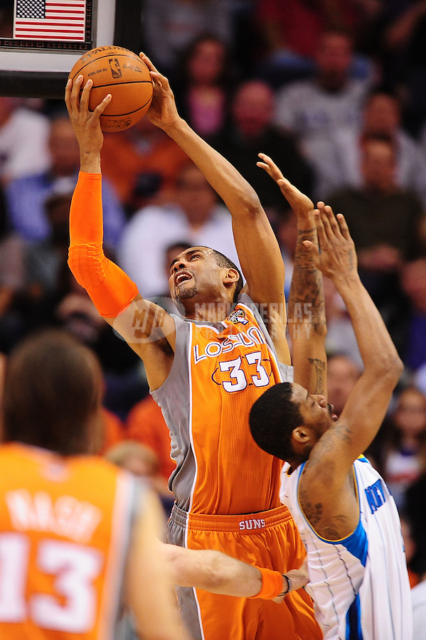 Mar. 25, 2011; Phoenix, AZ, USA; Phoenix Suns forward (33) Grant Hill drives to the basket against the New Orleans Hornets at the US Airways Center. The Hornets defeated the Suns 106-100. Mandatory Credit: Mark J. Rebilas-.