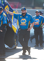 Oct 12, 2018; Concord, NC, USA; Crew member for NHRA funny car driver Ron Capps during qualifying for the Carolina Nationals at zMax Dragway. Mandatory Credit: Mark J. Rebilas-USA TODAY Sports