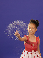 Young girl popping a big Soap Bubble