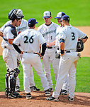 25 July 2010: Vermont Lake Monsters Manager Jeff Garber (26) has a meeting on the mound during a game against the Tri-City ValleyCats at Centennial Field in Burlington, Vermont. The ValleyCats came from behind to defeat the Lake Monsters 10-8 in NY Penn League action. Mandatory Credit: Ed Wolfstein Photo