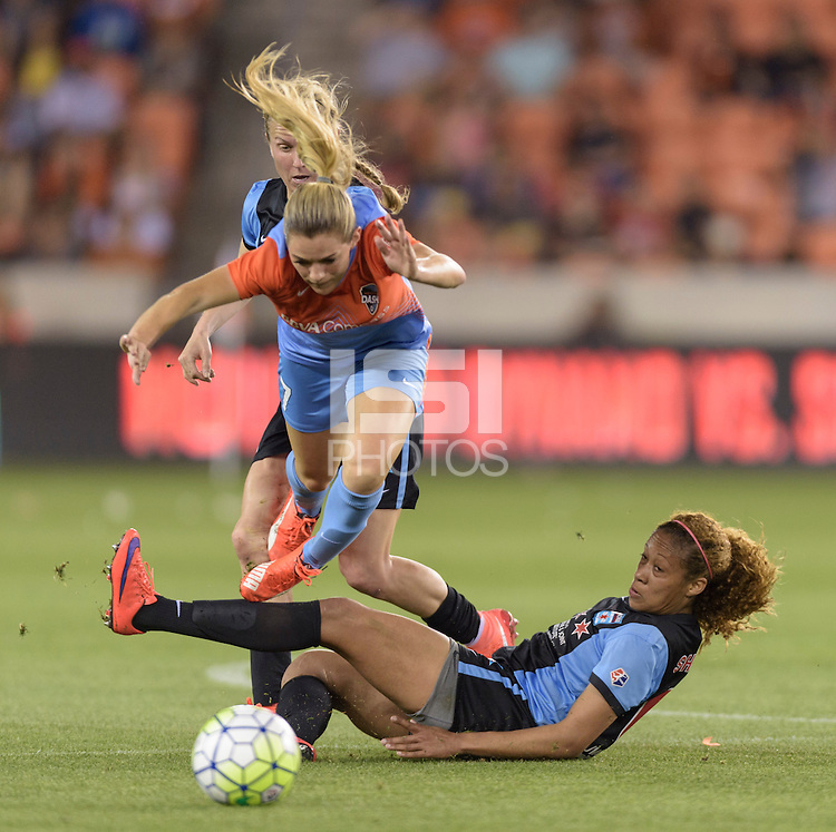 Houston Texas - Kealia Ohai (7) of the Houston Dash is tripped up by Casey Short (6) of the Chicago Red Stars in the first half on Saturday, April 16, 2016 at BBVA Compass Stadium in Houston Texas.  The Houston Dash defeated the Chicago Red Stars 3-1.