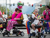 Grand Marshalls of Alaska PrideFest's 2015 Equality Parade Mad Myrna and The Raven owner Larry Kaiser lead parade floats through the streets of downtown Anchorage.