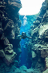 Exploring the Silfra crack where the American and Eurasian Tectonic plates meet. It is the only place where you can dive between two continents