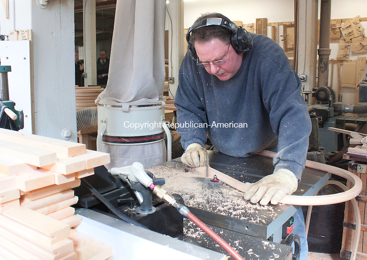 WINSTED CT.-OCTOBER 24 2013 102413DA09- Tom Mauleof Hitchcock Chairs in Winsted works on sanding down parts of a chair on Thursday. The company has received an order for 152 chairs for a restaurant in California. The chairs are designed with a patriotic, historical theme, such as the Boston Tea Party, Pilgrims discovering Plymouth Rock and Paul Revere.<br /> Darlene Douty Republican American