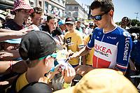 French National Champion Warren Barguil (FRA/Arkea Samsic) handing out signatures at the start in Saint-Dié-des-Vosges<br /> <br /> Stage 5: Saint-Dié-des-Vosges to Colmar (175km)<br /> 106th Tour de France 2019 (2.UWT)<br /> <br /> ©kramon