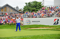 Hideki Matsuyama (JPN) sinks his birdie putt on 18 to win the  World Golf Championships - Bridgestone Invitational, at the Firestone Country Club, Akron, Ohio. 8/6/2017.<br /> Picture: Golffile | Ken Murray<br /> <br /> <br /> All photo usage must carry mandatory copyright credit (&copy; Golffile | Ken Murray)