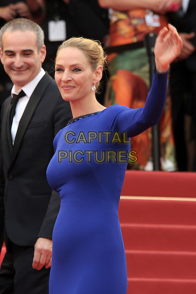 UMA THURMAN.The closing ceremony of the 64th Cannes Film Festival, Cannes..May 22nd, 2011.half length 3/4 purple blue indigo dress long sleeves hand arm in air waving side.CAP/JG.©Jacques Garrel/Capital Pictures