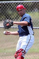 GCL Nationals Erick Fernandez #27 warms up a pitcher in the bullpen during a game against the GCL Mets at the Washington Nationals Minor League Complex on June 20, 2011 in Melbourne, Florida.  The Nationals defeated the Mets 5-3.  (Mike Janes/Four Seam Images)