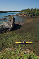 A kayaker explores the rugged shoreline of Lake Superior at Isle Royale National Park.