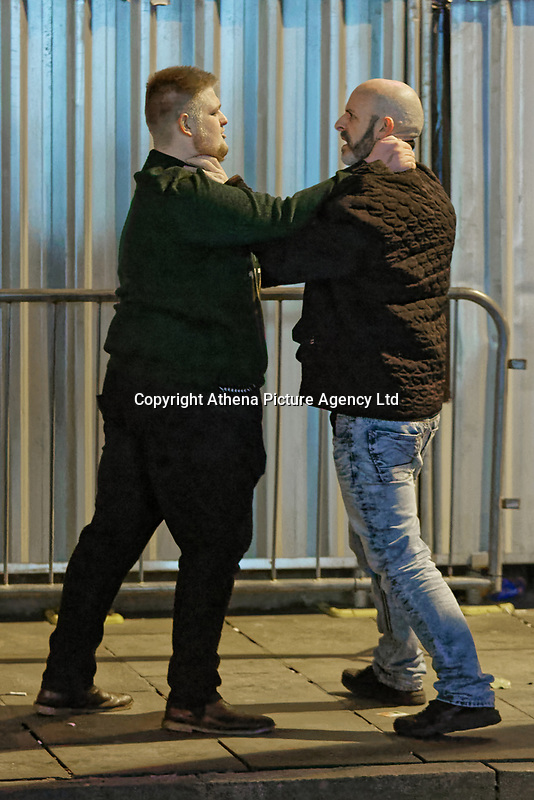 Pictured: Two men push each other. Friday 14 December 2018<br /> Re: Revellers in Wind Street, Swansea, Wales, UK.