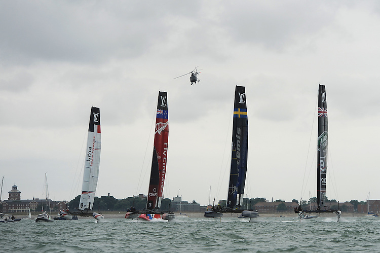 Groupama Team France, Emirates Team New Zealand, Artemis Racing and Land Rover BAR race towards the first mark during day two of the Louis Vuitton America's Cup World Series racing, Portsmouth, United Kingdom. (Photo by Rob Munro/Stewart Communications)