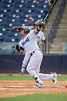Tampa Tarpons third baseman Angel Aguilar (7) follows through on a swing during a game against the Lakeland Flying Tigers on April 8, 2018 at George M. Steinbrenner Field in Tampa, Florida.  Lakeland defeated Tampa 3-1.  (Mike Janes/Four Seam Images)